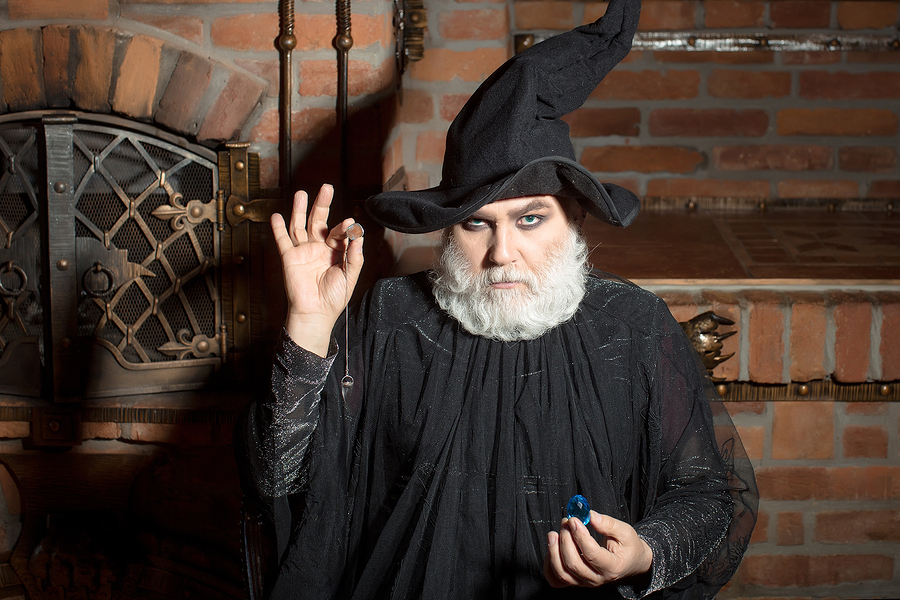 Old Wizard In Black Costume